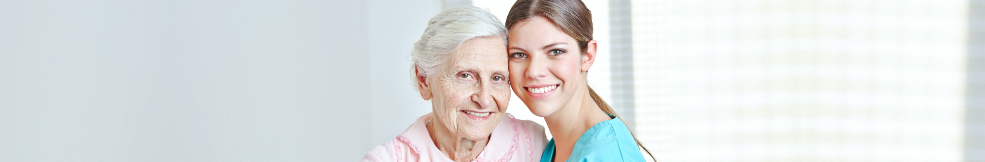 senior woman and young caregiver