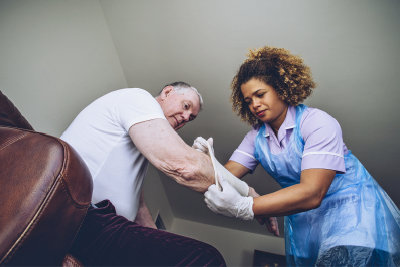 nurse putting bandage to a senior man